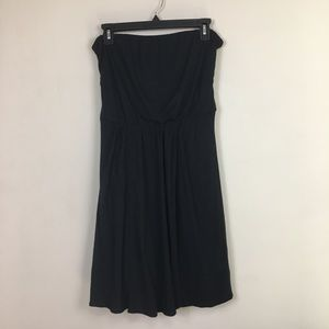 The limited black strapless dress